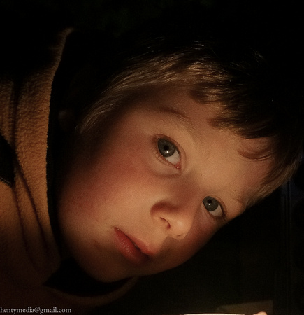 Boy in candle light